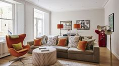 Informal Living Room with Orange Accents and White Walls