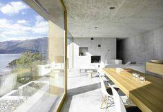 Il salotto con sala da pranzo sono racchiusi in unico spazio comunicante, dove il panorama fa da cornice. Anche in questo ambiente legno e cemento convivono armoniosamente