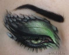 Green eyes with scale/feathers. wish i could do this
