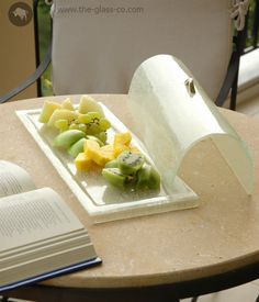 Glass serving platter with lid for room amenities and in room dining. Design by Glass Studio www.the-glass-co.com