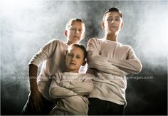 These three brothers are looking totally awesome! Love the smokey background and their poses. Such a cool family shot.