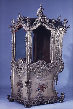 Sedan chair. 1750-60. Every Saturday four liveried footmen carry me to Sainsbury's in this. True story.