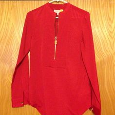 Michael Kors blouse Worn once. Perfect condition. Gold zipper and buttons on sleeve. Size XS MICHAEL Michael Kors Tops Blouses