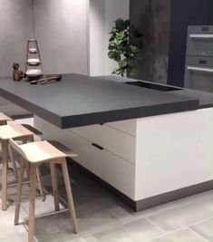 This sliding kitchen island utilizes the Accuride Heavy-Duty Linear Track System. The is a state-of-the-art sliding solution that supports loads up to 793 lbs, accommodating large screens, Kitchen Island Decor, Kitchen Room Design, Modern Kitchen Design, Home Decor Kitchen, Interior Design Kitchen, Kitchen Islands, Movable Island Kitchen, Kitchen Ideas, Modern Kitchen Island