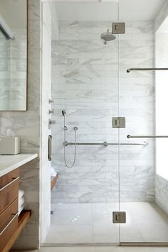 glass shower enclosure with U-channel and frameless door, marble shower, white bathroom. Beautiful shower!