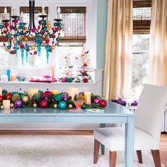 Let your dining room dazzle this holiday. Bring color and luster from the Christmas tree onto the dining table by clustering Christmas ornaments, candles, and greenery in a stunning centerpiece. For a touch of glamour, drape the chandelier with ball garland and ornaments.
