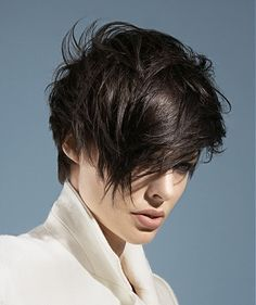 A short brown straight spikey messy Rock-Chick hairstyle by Peter Prosser