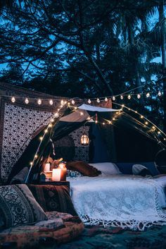 Outdoor tent hangout for bonfire with roadtrip adventure explore friends with tapestry fringe and lights for Bohemia bohemian gypsy hippie interior exterior decorations for summer spring