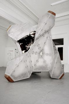"""White Elephant (Privately Soft)"" by Jimenez Lai. Lai describes it as ""a building inside a building,"" falling ""somewhere between super-furniture and a small house."" It's a flippable object, able to be tilted and set on any side. It tumbles, in the architect's words, its cowhide-padded interior offering a place to sit in any orientation."