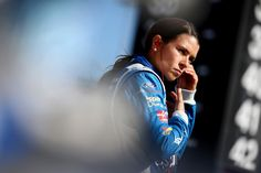 Danica Patrick Photos Photos - Danica Patrick, driver of the #10 Aspen Dental Ford, stands by her car during qualifying for the Monster Energy NASCAR Cup Series Auto Club 400 at Auto Club Speedway on March 24, 2017 in Fontana, California. - Auto Club Speedway - Day 1