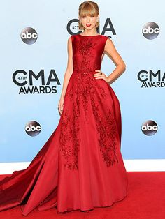 TAYLOR SWIFT The country cutie looks all grown up in a showstopping scarlet Elie Saab gown with delicate embroidery, plus a refined updo and her signature red lip.