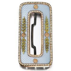 A Fabergé two-colour gold, enamel and seed pearl belt buckle, workmaster Michael Perchin, St. Petersburg, 1899-1903, rounded rectangular, the surface enamelled in translucent powder blue over banded wavy engine-turning and applied with gold rosettes and leaf trails, the gold borders set with seed pearls.