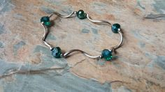 emerald green bead with a silver wave bracelet by SpryHandcrafted on Etsy Handmade Beads, Handmade Gifts, Emerald Green, Rose Quartz, Belly Button Rings, Copper, Bronze, Pearls, Crystals