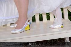 Hand painted Disney wedding shoes for a gorgeous bride and very cute flower girl #disney #wedding #bride #disneyprincessshoes #disneyprincess #bridal #flowergirl #beautyandthebeast #beauty #beast