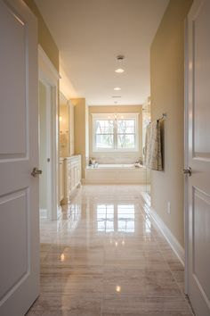 French doors open to a bright bath in this Cambridge Model Home by @infinityh
