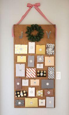 modern luxe advent calendar - love the mini binder clips holding envelopes