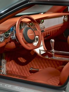 Spyker interior is amazingly beautiful.  Note the shift mechanism and quilted leather.  Unique to Spyker cars.