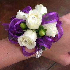 Purple ribbon, white rose wrist corsage
