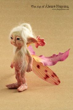 Orchid sprite - Resin casted ooak art doll faerie fairy pixie flower cymbidium orchid. €99.95, via Etsy.