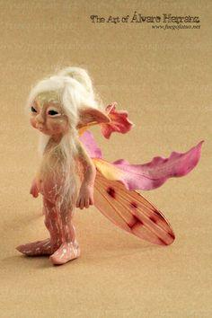Orchid sprite - Resin casted ooak art doll faerie fairy pixie flower cymbidium orchid. €99.95, via Etsy.