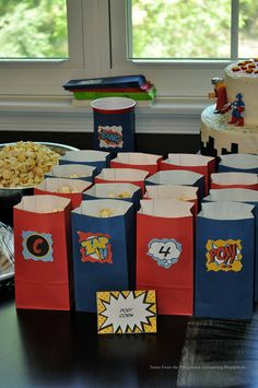 Superhero Party (maybe you could do puppy chow or something like that instead of popcorn, cuz popcorn isn't too great after it's cold)