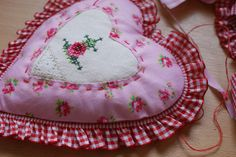 sewing a sweet heart ♥ by dutch blue, via Flickr (vintage linen featured in centre)