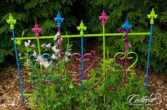 Painted iron gate. Previously rusty, peeling white paint - I scraped, sanded, sprayed several coats of Rustoleum as a base. Then hand painted several coats of various colors. Labor intensive but pretty.