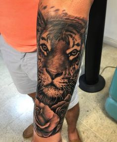 Grey Rose Flower And Tiger Head Tattoo On Left Sleeve by Gutti Canvasink