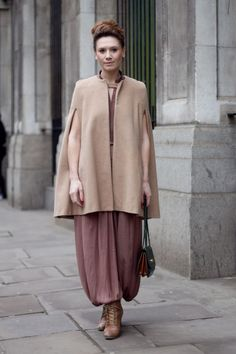 Coggles London Street Style with camel cape, raspberry jumpsuit, camel lace-up  heels and black bag