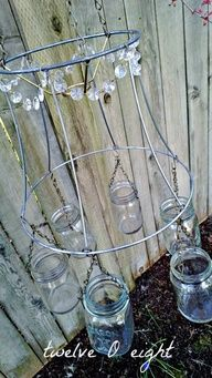 Tomato cage  Mason Jar chandelier  add chunky beads from Craft Store  insert tea lights.  Romance for your back porch or hanging from a branch over your picnic table!