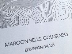 This detailed and beautifully printed letterpress poster of Maroon Bells, Colorado portrays the mountainous area using dark grey contour lines.