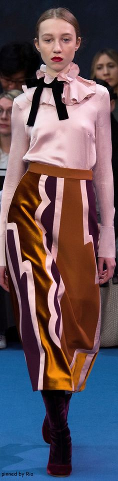 This is a celebration of how far women's rights in the workplace has came. We can wear a pink ultra romantic shirt with a 70s print maxi dress without fear of our position and competence being questioned. No more 80s menswear-inspired power suits. YES! Roksanda Fall 2016 RTW l Ria