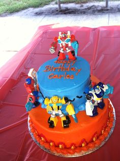 Rescue Bots Birthday cake. Close up of the previous cake. $48 two tier cake from Walmart, used the Harley Davidson bike design but changed the colors and told them I would add my own action figures.