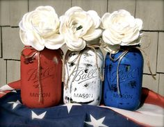Rustic Mason Jar Centerpieces for the 4th Of July by DIY Ready at http://diyready.com/4th-of-july-recipes-and-party-ideas/