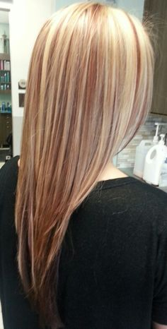 Blonde hair with red paneled lowlights.