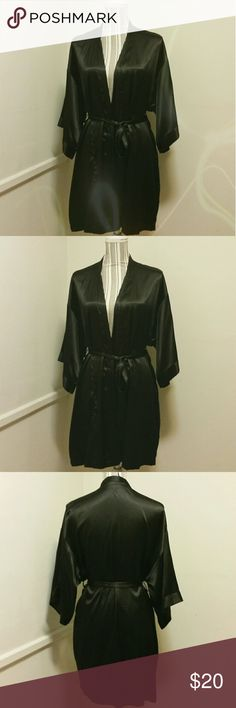 Victoria's Secret Sexy Black Silk Like Robe S/M Sexy Pre-loved Women's Victoria's Secret Black Silk - like Robe in Size Small/Medium. Has slight blemish on lower right side (long snag). Otherwise in good condition. Measurements: Length - 34.5 inches and Sleeve - 11 inches. Victoria's Secret Intimates & Sleepwear Robes