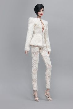 """Broad shoulder structured jacket in cream faux fur Skinny pants in cream lace Both fully lined Jacket (front closure with hook) Pants (Back closure with hook) Doll & other accessories are not included. Fits most 12"""" fashion dolls (e.g. Fashion Royalty, Nuface, Colour Infusion, Barbie etc)"""