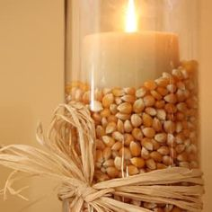 """Use a can or a tin inside the vase - the candle will stay stable and you'll use less filling material.     22 Holiday Decor Hacks That'll Make You Say """"Why Didn't I Know About These Sooner?"""""""