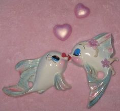 Kissing fish wall plaques from vintage fish molds.