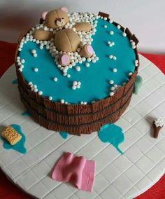 Cake bear floating in wood tub