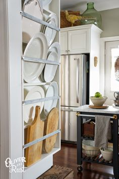 love this - from the plate rack to the kitchen cart to the display over the fridge cabinet