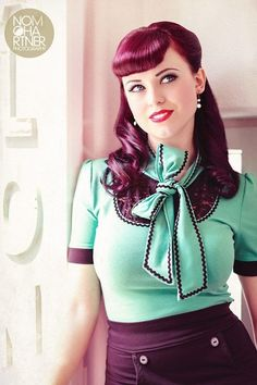 Rockabilly girl in retro hairdo and mint green blouse with bow & black rickrack trim