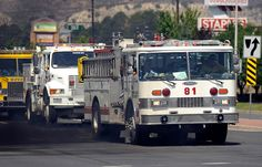 Group of firetrucks are heading to the Waldo Canyon fire site from the corner of Garden of Gods Rd. and Centennial Blvd. in Colorado Springs on Wednesday in Colorado Springs, Colo, June 27. Hyoung Chang, The Denver Post