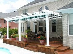 deck with pergola... love the contrast of the white paint and natural wood...
