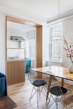 The renovation reorganised the existing one-bedroom unit to include another bedroom that doubles as an office, as well as a powder room and a reorganised galley-style kitchen.