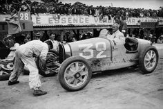 Louis Chiron in his Type 54 Bugatti on a pit stop during the Montlhery Grand Prix of 1931.