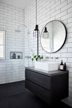 Bathroom White subway tiles are laid horizontally in this smaller bathroom, with the same large format black tiles on the floor. A circular mirror sits above a white basin and black timber vanity, with an industrial-style pendant lamp hangs above. Bathroom Renos, Bathroom Flooring, Bathroom Renovations, Basement Bathroom, Modern Bathroom, Small Bathroom, Black White Bathrooms, Black Vanity Bathroom, Bathroom Tray