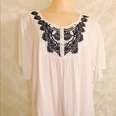 White top w/blue embroidery White colored blouse with beautiful blue embroidery. 100% cotton. 100% beautiful. Tops