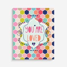 """With an effortless modern style, Lucy Darling offers a high-quality """"You Are Loved"""" honeycomb themed art print designed to help celebrate the darling moments of"""