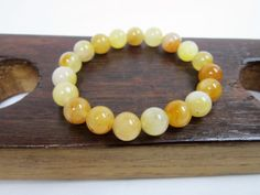 Check out this item in my Etsy shop https://www.etsy.com/listing/484343518/yellow-aventurine-bracelet-yellow